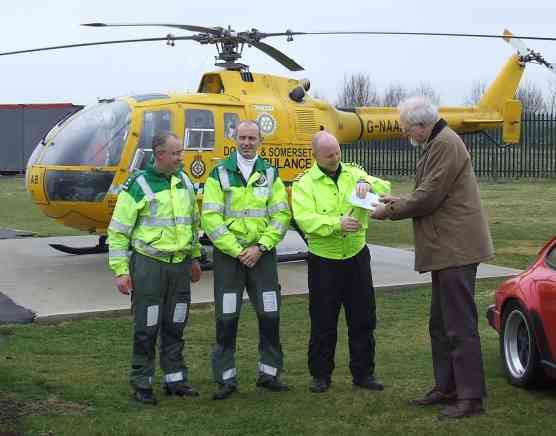 Presenting a cheque to the Air Ambulance service