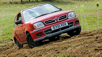 Production Car trials car climbing a hill