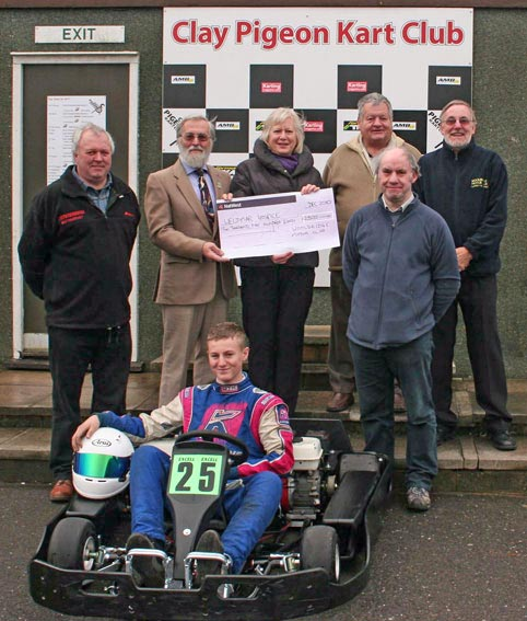 Charity go-kart event presenting cheque