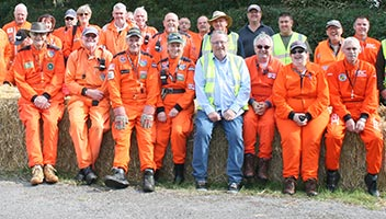 A large group of happy motorsport marshals